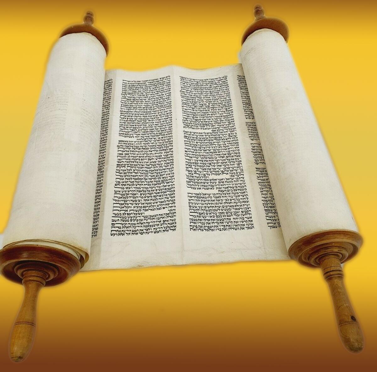 Torah scroll open on a golden background