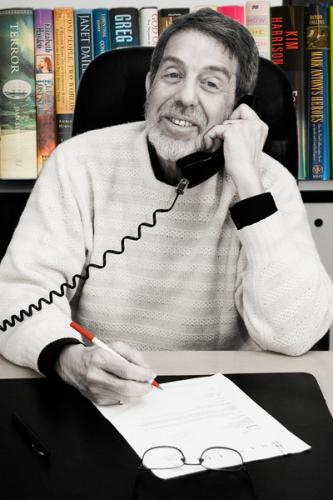 Richard-Curtis-on-phone-greyscale-1-with-books-L